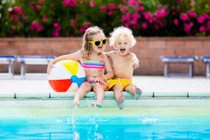 Two children by a pool